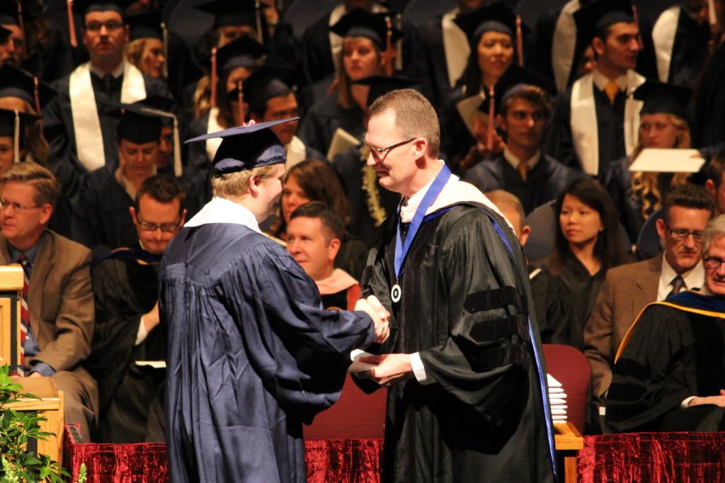Mark receiving his diploma.